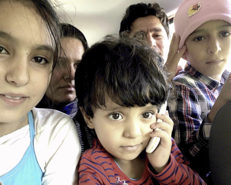 The refugee family that Robin and Robert transported to the registration center. Photo credit: Robin Shanti Jones