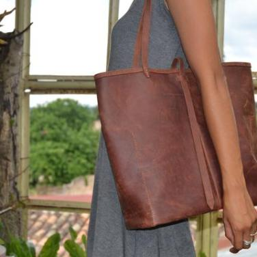 Signature Leather Tote. Every purchase provides 4 days of schooling for a child in Honduras. Price $169