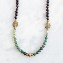 "African Sun Necklace. Featuring ""sun beads"" handmade in Nigeria and brass accent beads handmade in Ethiopia, this best-selling necklace is unique and versatile. 10% of your purchase goes towards empowering female entrepreneurs in Kenya through our partnership with the Sisi Fund. Price $32"