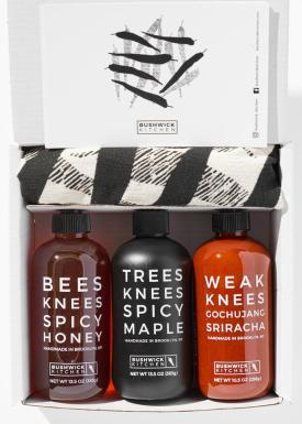 Three Knees Spicy Gift Set - The ultimate gift set for every hot sauce lover! This gift set comes with Bees Knees Spicy Honey, Trees Knees Spicy Maple, Weak Knees Gochujang Sriracha, Chile Pepper Dish Towel, and a set of Five Spicy Recipes.  $44.99 Impact: Every purchase provides 10 meals to children-in-need