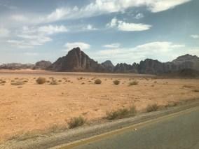 Barren landscape surrounding Wadi Rum