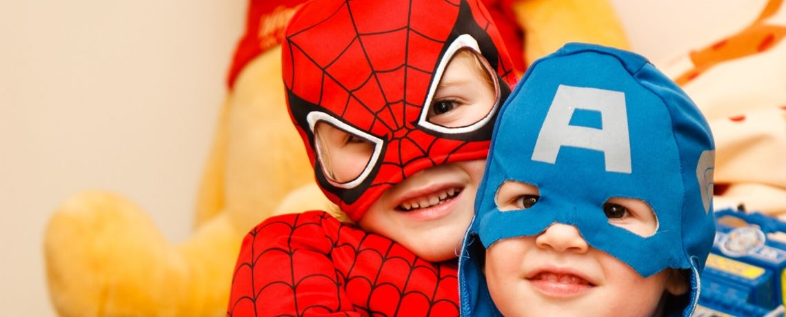 Two boys dressed as superheroes for Thirsk half term crafts