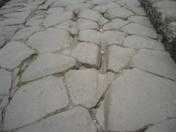 Pompeii road with cart tracks from informaltraveller.com