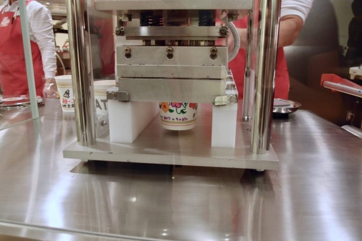 CupNoodles factory cup getting sealed