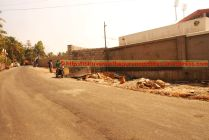 Newly widened and surfaced peripheral public road (Back side of stadium)