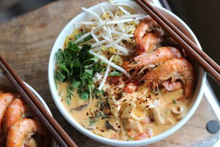 Coconut red curry noodle soup with chicken and prawns
