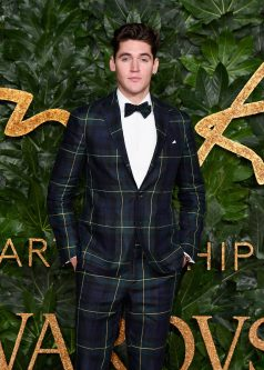 LONDON, ENGLAND - DECEMBER 10: Isaac Carew arrives at The Fashion Awards 2018 In Partnership With Swarovski at Royal Albert Hall on December 10, 2018 in London, England. (Photo by Jeff Spicer/BFC/Getty Images for BFC)