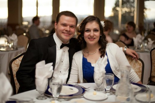 Tara with her husband in her blue dress