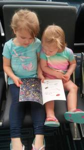 Enjoying an I Spy book during the wait