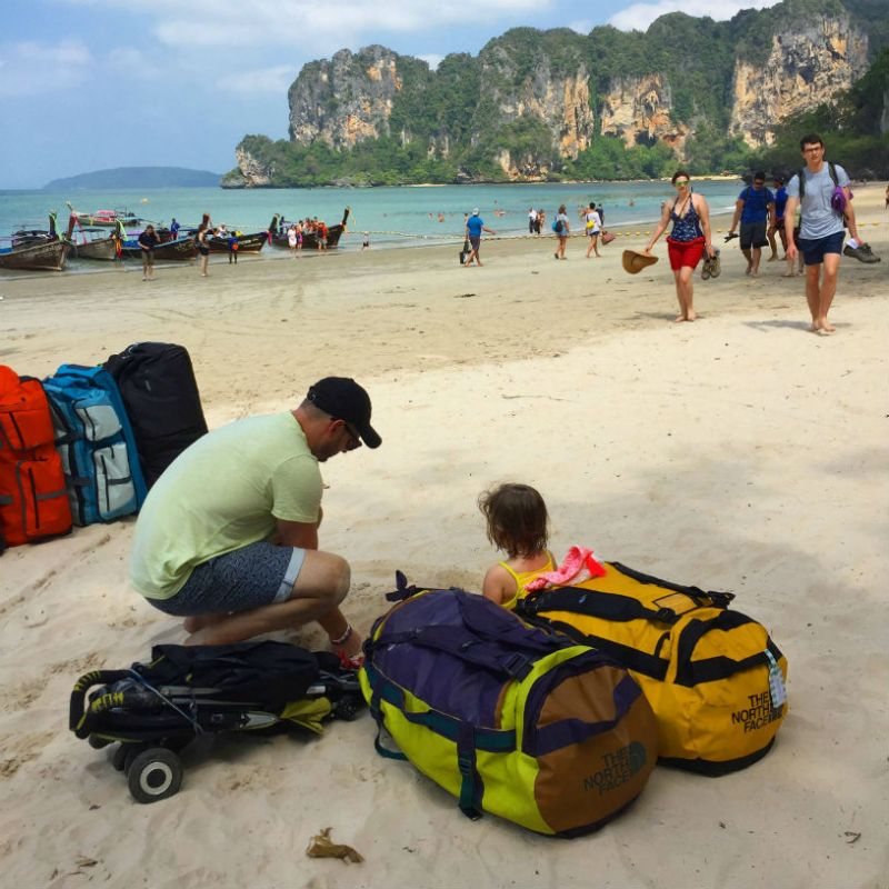 Thailand, beach, waiting for the boat - Tips for Thailand family holidays: travelling with a baby and a toddler