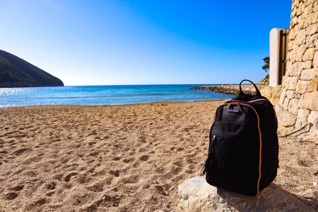 Travel hack backpack for women, El Portet beach