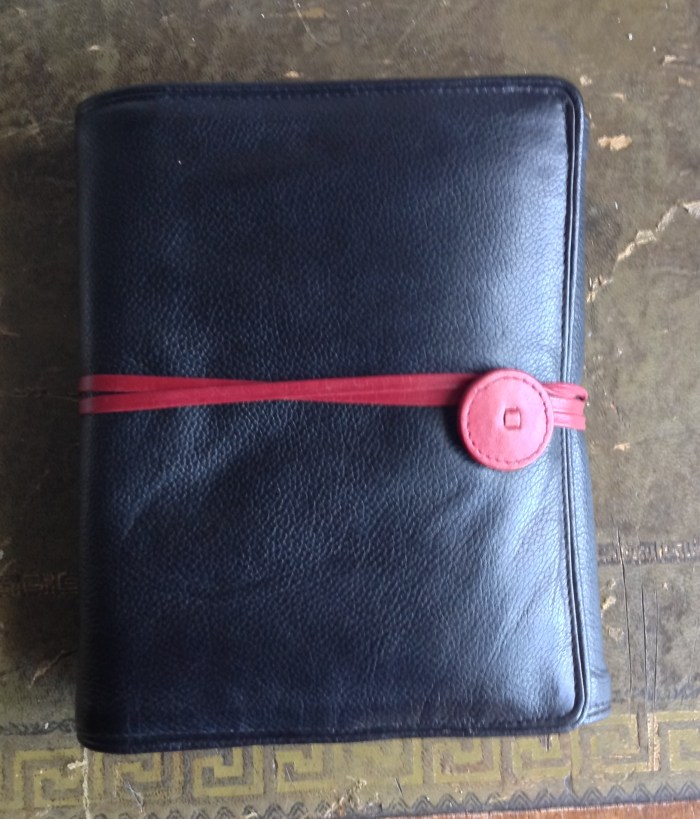 Soft, full-grain leather with wrap tie which allows exuberant overstuffing
