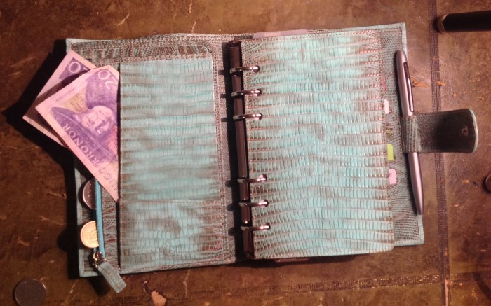 Coins and spare keys in zippered pocket, notes in front flap. I am not a silver person but this binder looks perfect with silver hardware