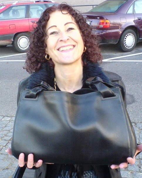 Forget the BAD hair colour and the stripey trousers the fashion police should have arrested me for - look at the joy on my face about my Gucci handbag!