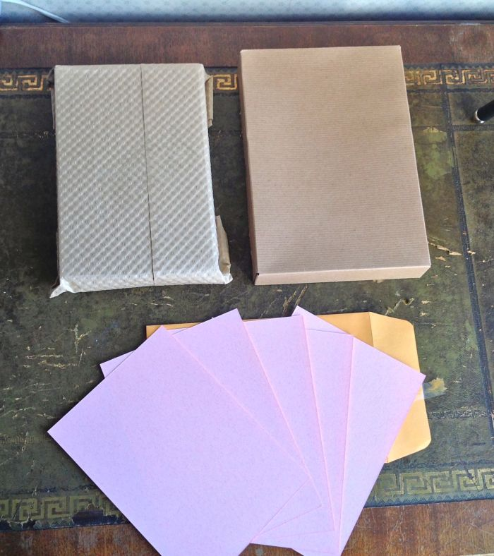 2 Seven Seas Writers Notebook to the left, 5 sheets blotting paper and a box