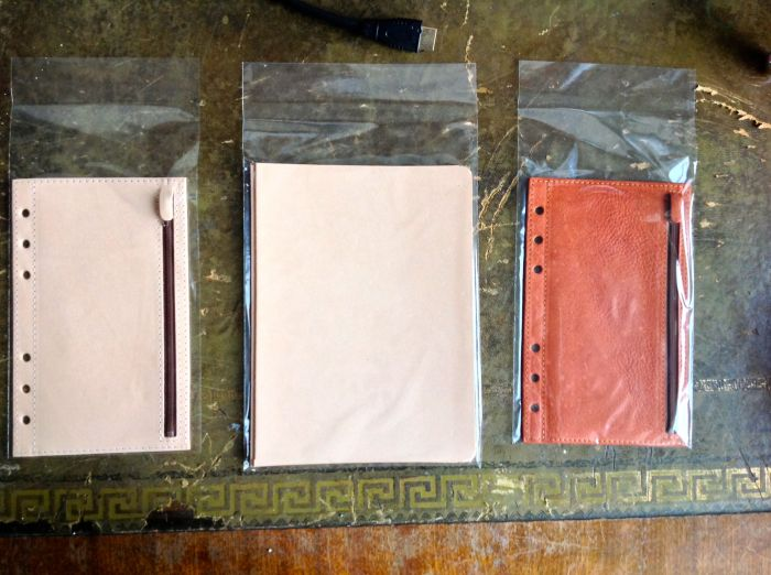 From left to right - the undyed zipped flyleaf with a plain back, two samples of undyed so I can put them next to the binder for comparison, and personal sized flyleaf with zip on one side and secretarial pocket on the other.