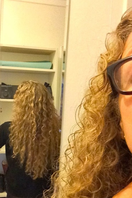 I took this one this morning. The curls pull up so when wet it is about 3 - 4cm longer.