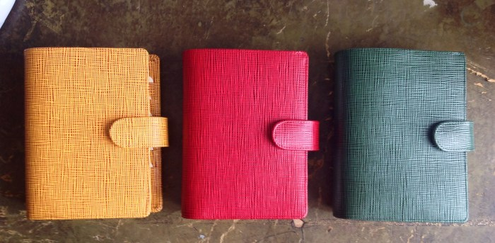 Van Der Spek 'LV' leather ring binders in green, red, and yellow