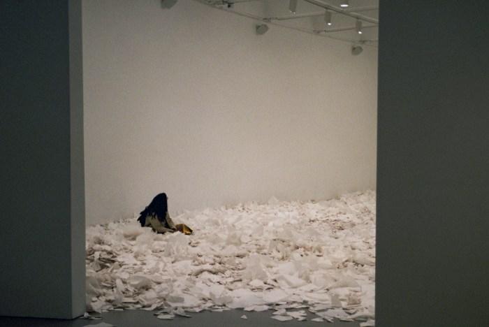 Woman Sitting in Ann Hamilton's At Hand Installation