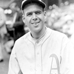 George Earnshawnotches the 12th consecutive victory for theA's, 6 - 5, atChicago.