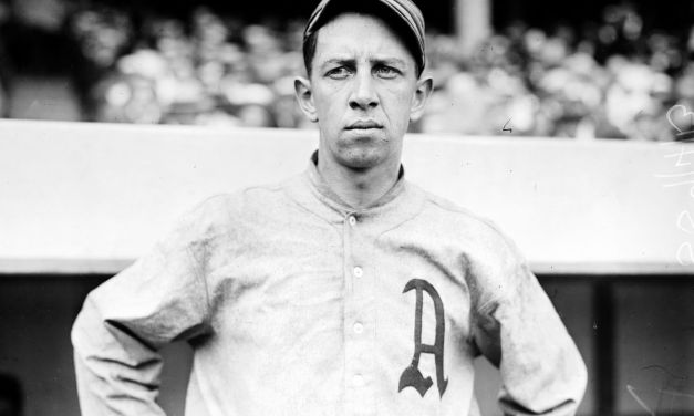 Chicago White Sox players give their former manager Eddie Collins a wristwatch and diamond stickpin on his return to Chicago with the A's