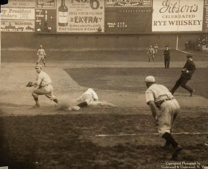 Bert Niehoff of Phillies slides into 3rd as the throw gets away from Larry Gardner of the Red Sox, at the Baker Bowl, Game 5 of the 1915 World Series, Oct 13, 1915.
