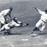 FLASHBACK Babe Ruth slides into home at Yankee Stadium on August 14, 1934, attempting to score on a ground ball hit to short. The throw from Billy Rogell is wide, but Detroit catcher Ray Hayworth made the tag to record the out. Later that season, the Tigers won the pennant.