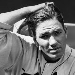 August 7, 1934 - Dizzy Dean becomes the first pitcher to reach 20 wins this season with a 2 - 0 shutout over the Reds.