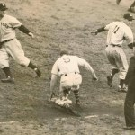 New York Yankees pitcher Lefty Gomez knocks in the winning run in the 4 - 2 clincher in Game 5 against the New York Giants