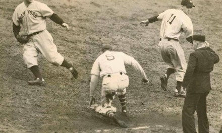 New York Yankees pitcher Lefty Gomez knocks in the winning run in the 4 – 2 clincher in Game 5 against the New York Giants