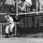 Al Gionfriddo of the Brooklyn Dodgers makes a game-saving catch against Joe DiMaggio of the New York Yankees in the sixth game of the World Series