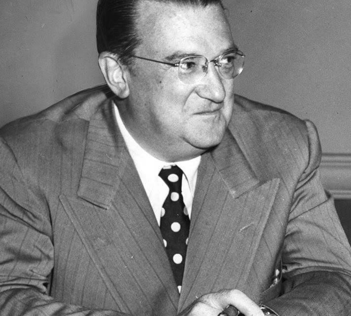 """Walter O'Malley succeeds Branch Rickey as president of the Dodgers. O'Malley, who had offered to buy Rickey's share of the club to become majority owner, is forced to pay more money when 'the Mahatma', in a final act of defiance about being told to leave the organization, offers his share of the team to a friend for a million dollars, a deal the new president believes, but can't prove, to be as """"fraudulent as a four-dollar bill."""""""