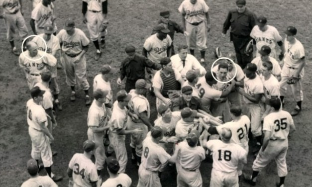 """With Giants manager Leo Durocher yelling """"stick it in his ear"""", Ruben Gomez hits Carl Furillo, the National League's leading hitter, on the wrist by a pitch. After taking first base, the Dodgers right fielder bolts into the opposing dugout to choke 'Leo the Lip', but in the melee, the knuckle on his little finger is fractured, putting an end to his season."""