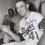After losing the opener to the Cubs, the Dodgers win the nitecap, 16 - 9, as pitcher Clem Labine gets his 3rd home run of the year. Labine has just three hits all year, but all three are homers.