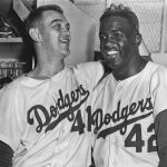 The Brooklyn Dodgers bounce back after Don Larsen's perfect game to tie the World Series in Game 6 on Jackie Robinson's walk off single