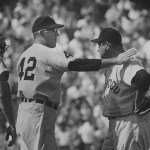 New York routs White Sox starter Early Wynn for a 12 - 5 victory. In the 3rd inning, Mickey Mantle legs out his third inside-the-park home run in a month.