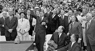 John F. Kennedy throws out the first ball to open the baseball season at new $23-million District of Columbia Stadium