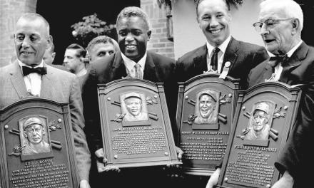 Jackie Robinson, Bob Feller, Bill McKechnie, and Edd Roush are inducted into the Hall of Fame.