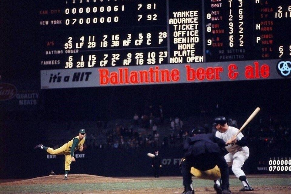"""AtYankee Stadium,New Yorkblows a 7 – 0 lead and allowsKansas Cityto tie the game and send it intoextra innings.Mickey Mantle, leading off the 11th, is fooled byBill Fischeron a slowcurve, then cannons a 2 – 2 pitch that almost clears the RF roof. """"The hardest ball I ever hit,"""" Mantle later comments, a ball that, by some accounts, is still rising when it strikes a foot below the top. It is conservatively estimated by Dr. James McDonald, a physicist who studies long-ball trajectories, that the ball would have traveled 620 feet if it had not struck the façade. """"That was the only homer I ever hit that thebatactually bent in my hands,"""" Mantle tellsDale Long, from whom he borrowed the bat."""