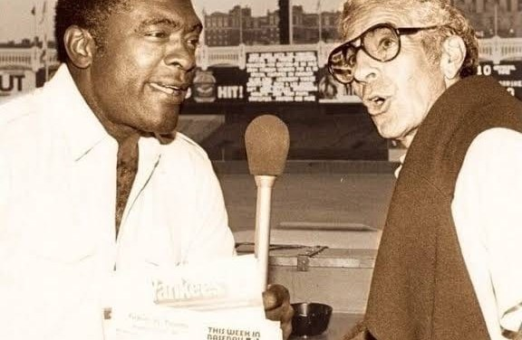 Bill White becomes the first black play-by-play broadcaster in major league history