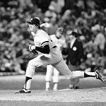 Ron Davis of the New York Yankees strikes out eight consecutive batters