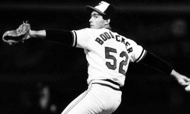 In the second game of the ALCS, Oriole hurler Mike Boddicker throws a five-hitter, beating the White Sox at Memorial Stadium, 4-0. The Baltimore right-hander, whose performance evens the series, establishes a playoff record when he strikes out 14 Chicago batters.