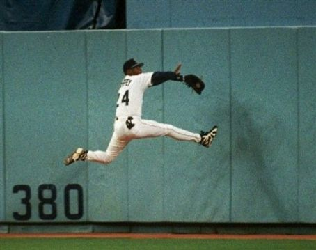 Ken Griffey Jr. of the Seattle Mariners breaks his wrist while making a spectacular catch