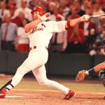 Mark McGwire of the St. Louis Cardinals hits his 65th home run, moving past Ted Williams and Willie McCovey