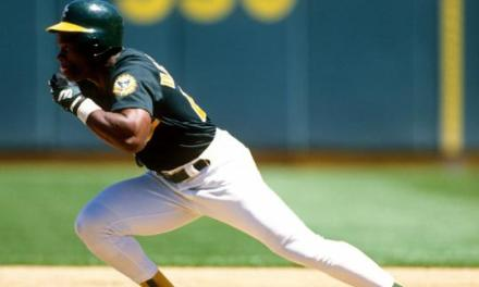 Rickey Henderson of the Oakland A's breaks Lou Brock's single-season stolen base record