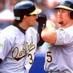 Mark McGwire becomes the fourth major leaguer to hit a home run over the left field roof at Tiger Stadium