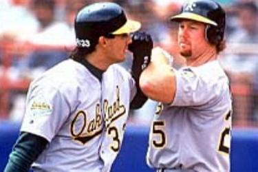 Mark McGwire of the Oakland A's becomes the first rookie to hit 30 home runs before the All-Star break