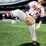 Warren Spahn of the Milwaukee Braves ties Hall of Famer Christy Mathewson by notching his 13th 20-win season