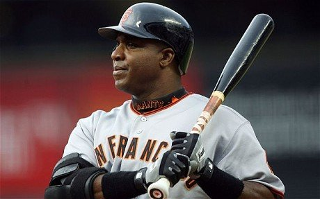 Slugger Barry Bonds avoids arbitration by agreeing to a five-year, $90 million deal with the San Francisco Giants