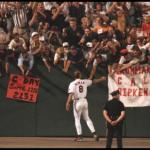 "After nearly 16 years of not missing a game, Cal Ripken, quietly and without fanfare, takes himself out of the lineup after playing in a major-league record 2,632 consecutive games. The Orioles shortstop's consecutive streak ends in Baltimore's 5-4 loss to the Yankees at Camden Yards in a nationally televised ESPN Sunday night game. ""Let's end it in the same place it started. In my home state. In front of friends and family. In front of the best fans in the world.""- Cal Ripken, Jr., commenting on ending his consecutive streak."